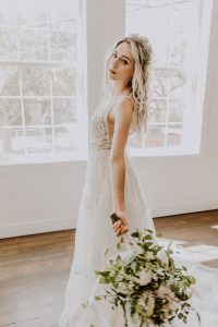 Becca Loft Standing in Beautiful White Dress with White Flowers